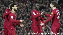 Liverpool's Mohamed Salah, front left, celebrates with teammates after scoring his side's opening goal during the English Premier League soccer match between Liverpool and Sheffield United at Anfield Stadium, Liverpool, England, Thursday, Jan. 2, 2020. (AP Photo/Jon Super) |