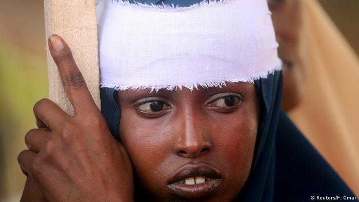 A woman with a white headband (Reuters/F. Omar)