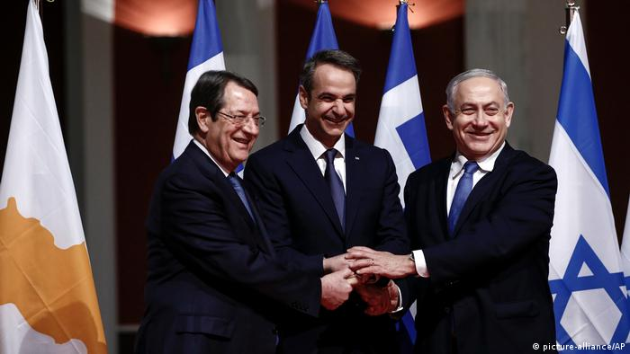 Greece's Prime Minister Kyriakos Mitsotakis, Cypriot President Nicos Anastasiadis, and Israeli Prime Minister Benjamin Netanyahu pose for a photograph ahead of the signing ceremony in Athens, on January 2, 2020