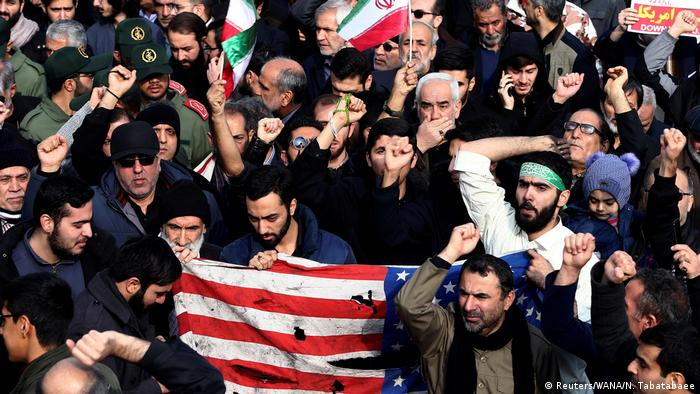 Protesters rip a US flag at a demonstration in Tehran following the killing of Qassem Soleimani (Reuters/WANA/N. Tabatabaee)