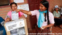 20.10.2019 A woman casts her vote in Villa 14 de Septiembre, in the Chapare region, Bolivia, Sunday, Oct. 20, 2019. Bolivians are voting in general elections Sunday where Bolivia's President Evo Morales is candidate for a fourth term. (AP Photo/Juan Karita)