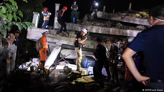Rescuers search for trapped workers after a seven-storey building under construction collapsed in southern Cambodia's coastal Kep province on January 3, 2020