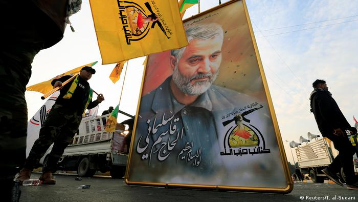 Kataib Hezbollah Iraqi militia hold the picture of the Iranian Major-General Qassem Soleiman