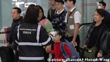 Sicherheitskontrollen am Hong Kong International Airport wegen unbekannter Krankheit in Festlandchina