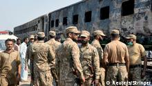 Army soldiers arrive at the place where a fire broke out in a passenger train and destroyed three carriages near the town of Rahim Yar Khan, Pakistan, October 31, 2019. REUTERS/Stringer NO RESALES. NO ARCHIVES.