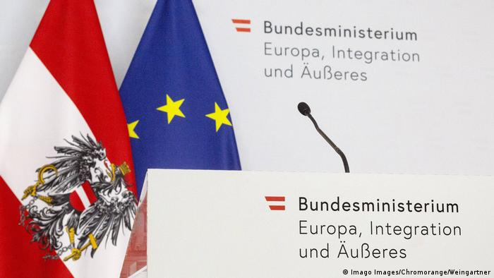 Flags and a podium at Austria's Foreign Ministry in Vienna