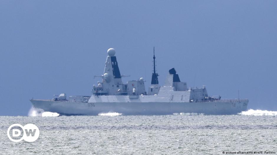 Russia says it fired warning shots at UK ship in its waters