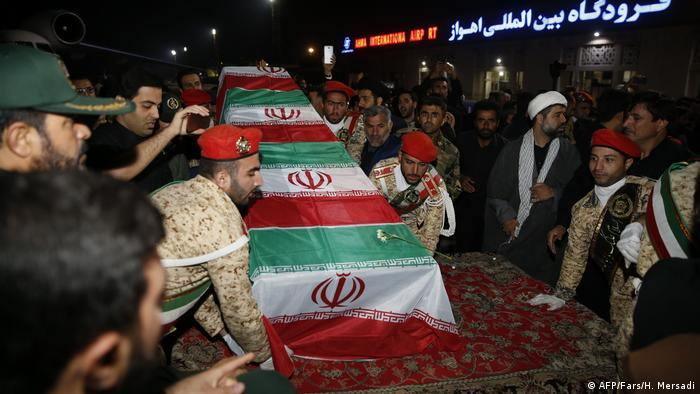 Military personnel carry the casket of Iranian commander Qassem Soleimani upon arrival at Ahvaz International Airport in Tehran on January 5, 2020