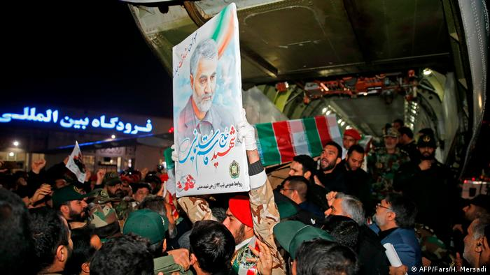 Crowds near Soleimani's coffin at the airport in Ahvaz (AFP/Fars/H. Mersadi)
