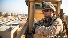03.02.2020 *** This handout image released courtesy of the US Department of Defense (DOD) shows US Marines with 2nd Battalion, 7th Marines, assigned to the Special Purpose Marine Air-Ground Task Force-Crisis Response-Central Command (SPMAGTF-CR-CC) 19.2, reinforcing the Baghdad Embassy Compound in Iraq on January 3, 2020. - US personnel at the American embassy in Baghdad, which has come under attack by pro-Iran protesters, are safe and there are no plans to evacuate, the State Department said on December 31, 2019. (Photo by Sgt. Kyle Tabot / DoD / AFP) / RESTRICTED TO EDITORIAL USE - MANDATORY CREDIT AFP PHOTO / DoD - US Marine Corps/ Sgt. Kyle C. Talbot - NO MARKETING NO ADVERTISING CAMPAIGNS - DISTRIBUTED AS A SERVICE TO CLIENTS ---