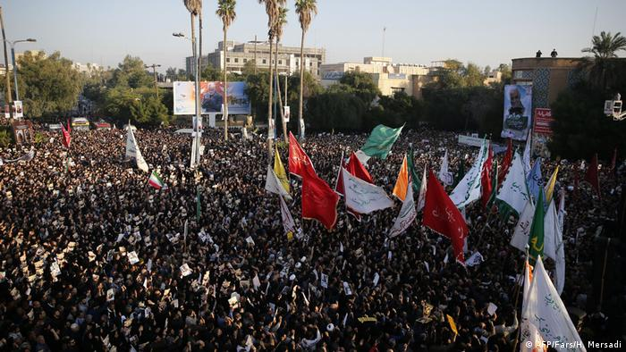 Iranians march through the streets of Ahvaz to pay homage to Qassem Soleimani