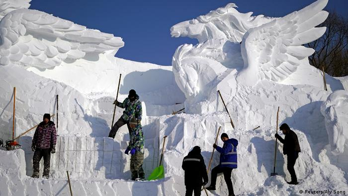 A snow sculpture with flying horses being worked on ahead of the Harbin Ice & Snow Festival (Reuters/Aly Song)