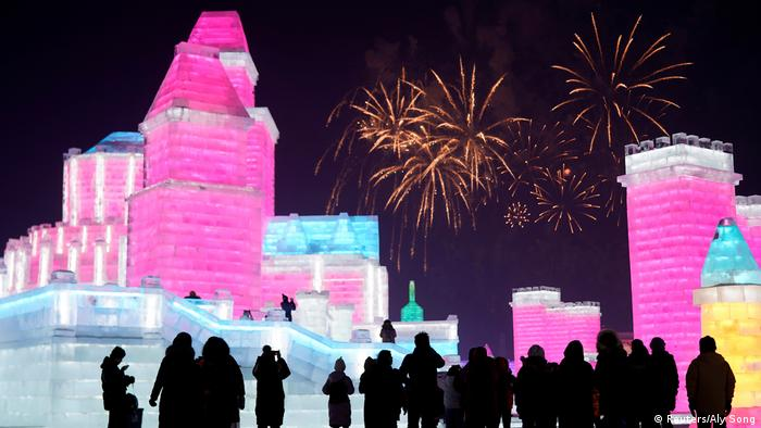 City of ice at the Harbin Ice & Snow Festival, with fireworks in the background (Reuters/Aly Song)