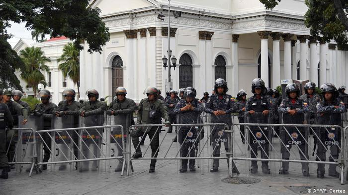 Police stand guard outside Venezuela's parliament