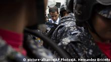 05.01.2020 *** National Assembly President Juan Guaido, Venezuela's opposition leader, is blocked by police from arriving to the Assembly where he is scheduled to lead the session to elect new Assembly leadership in Caracas, Venezuela, Sunday, Jan. 5, 2020. The opposition-controlled National Assembly is expected to decide whether to keep Guaidó as its leader for a second year in a special session inaugurating the final year of its 2015-2020 legislative period. (AP Photo/Andrea Hernandez Briceño) |
