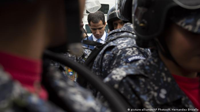 National Assembly President Juan Guaido, Venezuela's opposition leader, is blocked by police from arriving to the Assembly