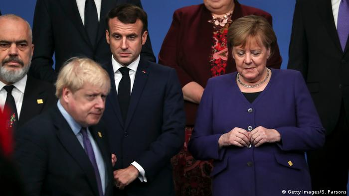 Boris Johnson, Angela Merkel i Emmanuel Macron