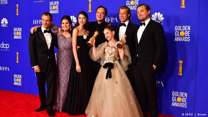 Team for Once Upon a Time...in Hollywood photographed in front of a Golden Globes backdrop