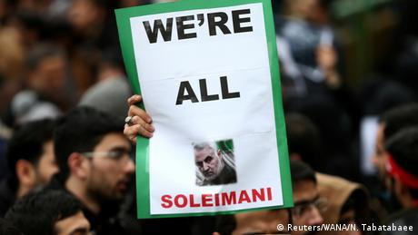 An Iranian man holds up a sign saying We're all Soleimani (Reuters/WANA/N. Tabatabaee)