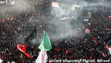 6.1.2020*** Mourners attend a funeral ceremony for Iranian Gen. Qassem Soleimani and his comrades, who were killed in Iraq in a U.S. drone strike on Friday, at the Enqelab-e-Eslami (Islamic Revolution) square in Tehran, Iran, Monday, Jan. 6, 2020. (AP Photo/Ebrahim Noroozi)