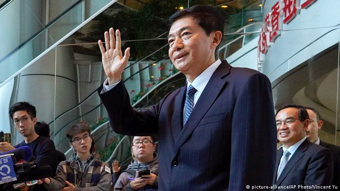 Liaison Office Luo Huining waving to the public assembled as he arrived in Hong Kong