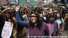 India: Women protest against violence Women wear blindfold and apply red color during a demonstration to protest agains (imago images/Pacific Press Agency)