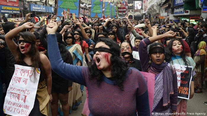India: Women protest against violence Women wear blindfold and apply red color during a demonstration