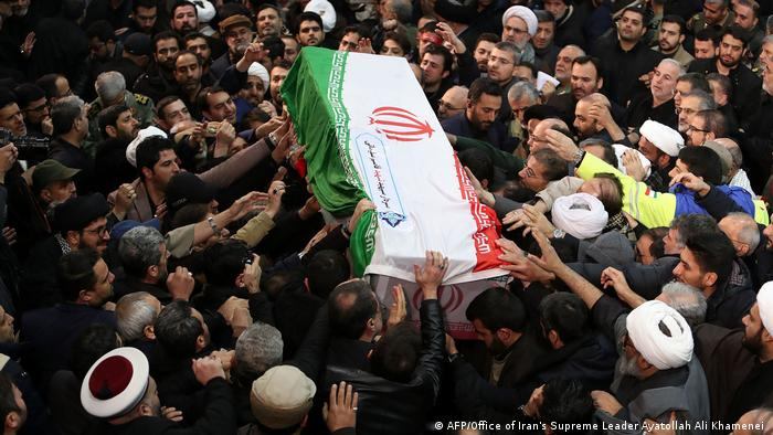 The coffin of slain general Qassem Soleimani is passed among the crowds in Tehran (AFP/Office of Iran's Supreme Leader Ayatollah Ali Khamenei)