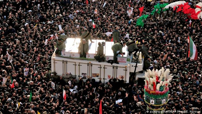 Crowds, seen from above, accompany the coffins of Soleimani and others killed in Iraq by a US drone strike