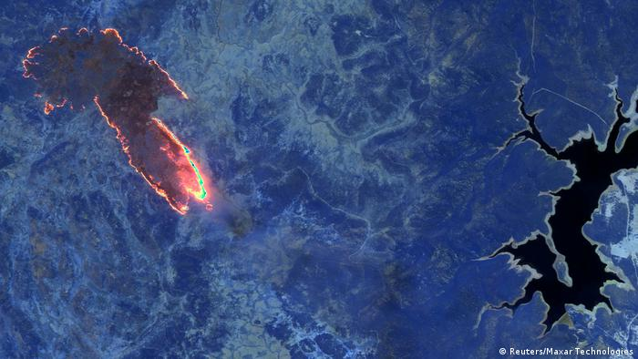 A satellite image shows a mushroom shaped chunk of land on fire in Australia