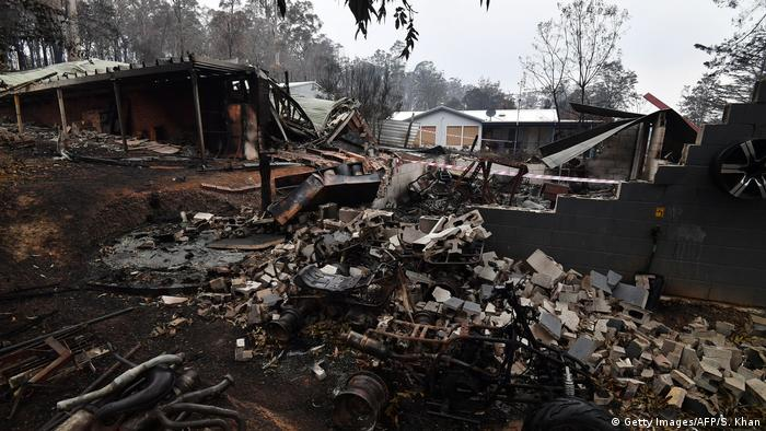 Houses gutted by bushfires in Mogo Village, NSW (Getty Images/AFP/S. Khan)