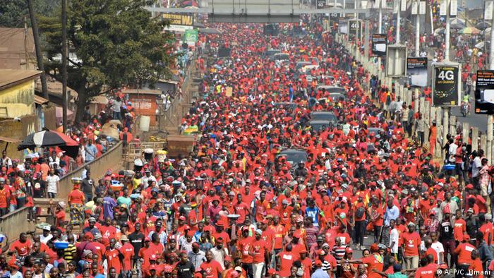 A large protest march with participants wearing red (AFP/C. Binani)