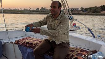 Mohammed Qenawy, a tour guide in Egypt on a Nile boat