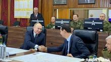 Russian President Vladimir Putin shakes hands with Syria's President Bashar al-Assad in Damascus, Syria in this handout released by SANA on January 7, 2020. SANA/Handout via REUTERS ATTENTION EDITORS - THIS IMAGE WAS PROVIDED BY A THIRD PARTY. REUTERS IS UNABLE TO INDEPENDENTLY VERIFY THIS IMAGE