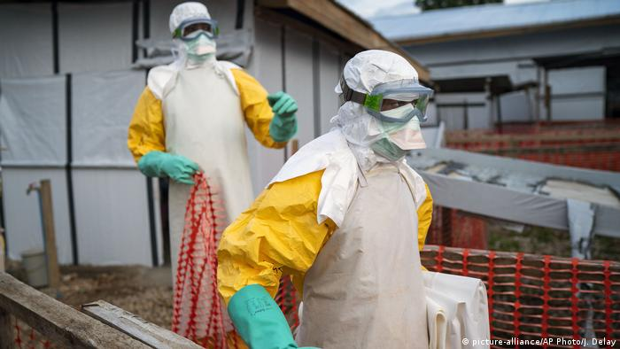 Two medical workers in protective suits during the Ebola outbreak in DR Congo