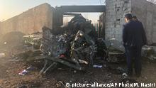 Debris is seen from a plane crash on the outskirts of Tehran, Iran, Wednesday, Jan. 8, 2019. A Ukrainian airplane carrying at least 170 people crashed on Wednesday shortly after takeoff from Tehran's main airport, killing all onboard, state TV reported. (AP Photos/Mohammad Nasiri) |