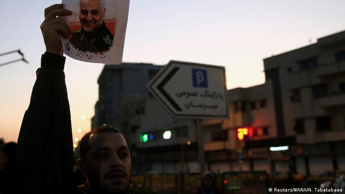 A man holds up a sign with a picture of General Soleimani in tehran (Reuters/WANA/N. Tabatabaee)