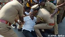 Protesters are detained by police during a nationwide general strike called by trade unions aligned with opposition parties to protest the Indian government's economic policies in Chennai on January 8, 2020. (Photo by Arun SANKAR / AFP)
