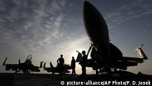 FILE- In this Nov. 22, 2016 file photo, U.S. Navy sailors stand by fighter jets on the deck of the U.S.S. Dwight D. Eisenhower in the Persian Gulf. The United States' Gulf allies have pushed for hawkish policies by Washington to pressure, isolate and cripple Iran, but this high-stakes strategy is now being put to the test by the surprise U.S. killing of Iran's most powerful military commander. The killing appears to have caught America's Gulf allies off-guard and threatens to draw Gulf states further into the cross-hairs of rising tensions between Washington and Tehran. (AP Photo/Petr David Josek, File) |