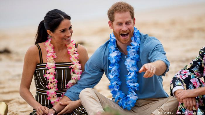 Meghan and Harry laughing on Sydney's Bondi Beach in 2018