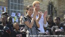 """FILE - In this Monday, Sept, 23, 2019 file photo, Britain's Prince Harry and Meghan, Duchess of Sussex greet youths on a visit to the Nyanga Methodist Church in Cape Town, South Africa. In a stunning declaration, Britain's Prince Harry and his wife, Meghan, said they are planning """"to step back"""" as senior members of the royal family and """"work to become financially independent."""" A statement issued by the couple Wednesday, Jan. 8, 2020 also said they intend to """"balance"""" their time between the U.K. and North America (Courtney Africa/Pool via AP, File) 