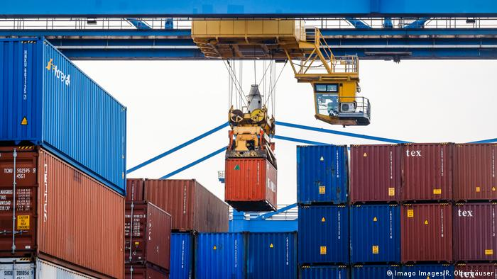 Containers being moved at the Port of Duisburg in Germany