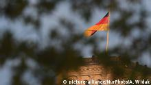 A view of a German flag over the Reichstag building, the seat of the German Parliament as German Chancellor Angela Merkel meets NATO General Secretary Jens Stoltenberg. On Thursday, November 7, 2019, in Berlin, Germany. (Photo by Artur Widak/NurPhoto) | Keine Weitergabe an Wiederverkäufer.