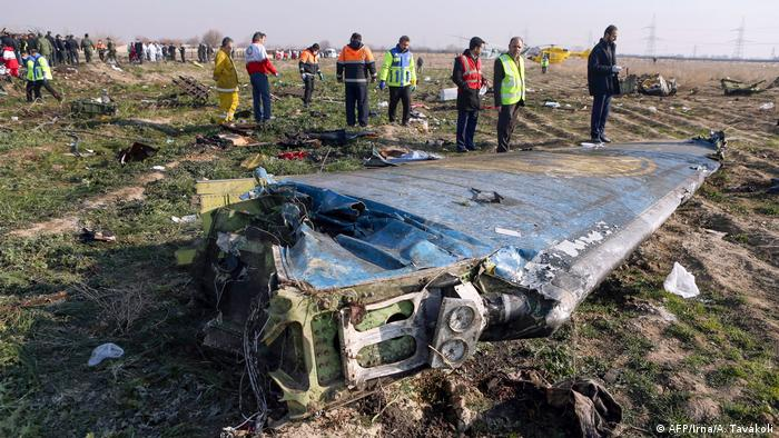 In this file handout photo provided by the Iranian news agency IRNA on January 8, 2020, rescue teams work at the scene of a Ukrainian airliner that crashed shortly after take-off near Imam Khomeini airport in the Iranian capital Tehran
