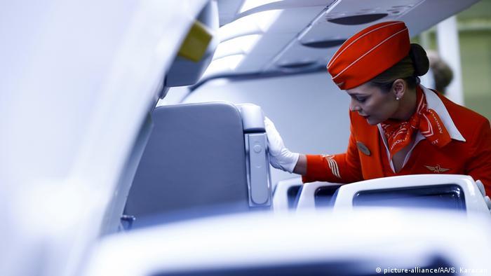Cabin crew member on a plane in Russia