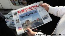 11.01.2020 *** An Iranian holds a newspaper with a picture of the debris of the Ukrainian plane that crashed in Tehran earlier this week, outside a news stand in the Islamic republic's capital on January 11, 2020. - Iran said it unintentionally shot down a Ukrainian passenger jet earlier this week, killing all 176 people on board, in an abrupt about-turn after initially denying Western claims it was struck by a missile. (Photo by ATTA KENARE / AFP) (Photo by ATTA KENARE/AFP via Getty Images)