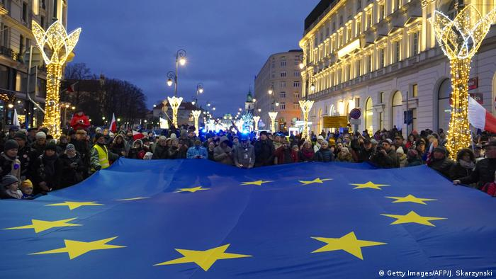 Protesters hold a EU flag on January 11, 2020 in Warsaw, Poland, during the 'March of a Thousand Robes', a protest against a bill backed by Poland's right-wing government.
