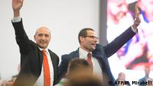 Labour party leader candidates Chris Fearne (L) and Robert Abela (R) wave to delegates prior to Malta's outgoing Prime Minister and outgoing Labour party leader deliver his final speech as PM on January 10, 2020 in Paola, Malta, before standing down over a slain reporter scandal. - Outgoing prime minister Joseph Muscat, who has been accused of obstructing justice by protecting political allies and aides, within a scandal-dogged probe into the murder of investigative reporter Daphne Caruana Galizia, is bowing out of the political limelight. A new leader of the labour party is to be elected on January 11 and then sworn in shortly after as new Prime Minister. (Photo by Matthew Mirabelli / AFP)