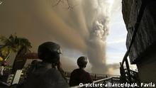 People watch plumes of smoke and ash rise from as Taal Volcano erupts Sunday Jan. 12, 2020, in Tagaytay, Cavite province, outside Manila, Philippines (AP Photo/Aaron Favila) |