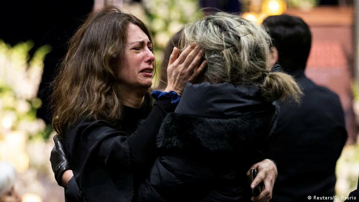 Mourners attend a memorial service in Toronto for those who died in plane crash